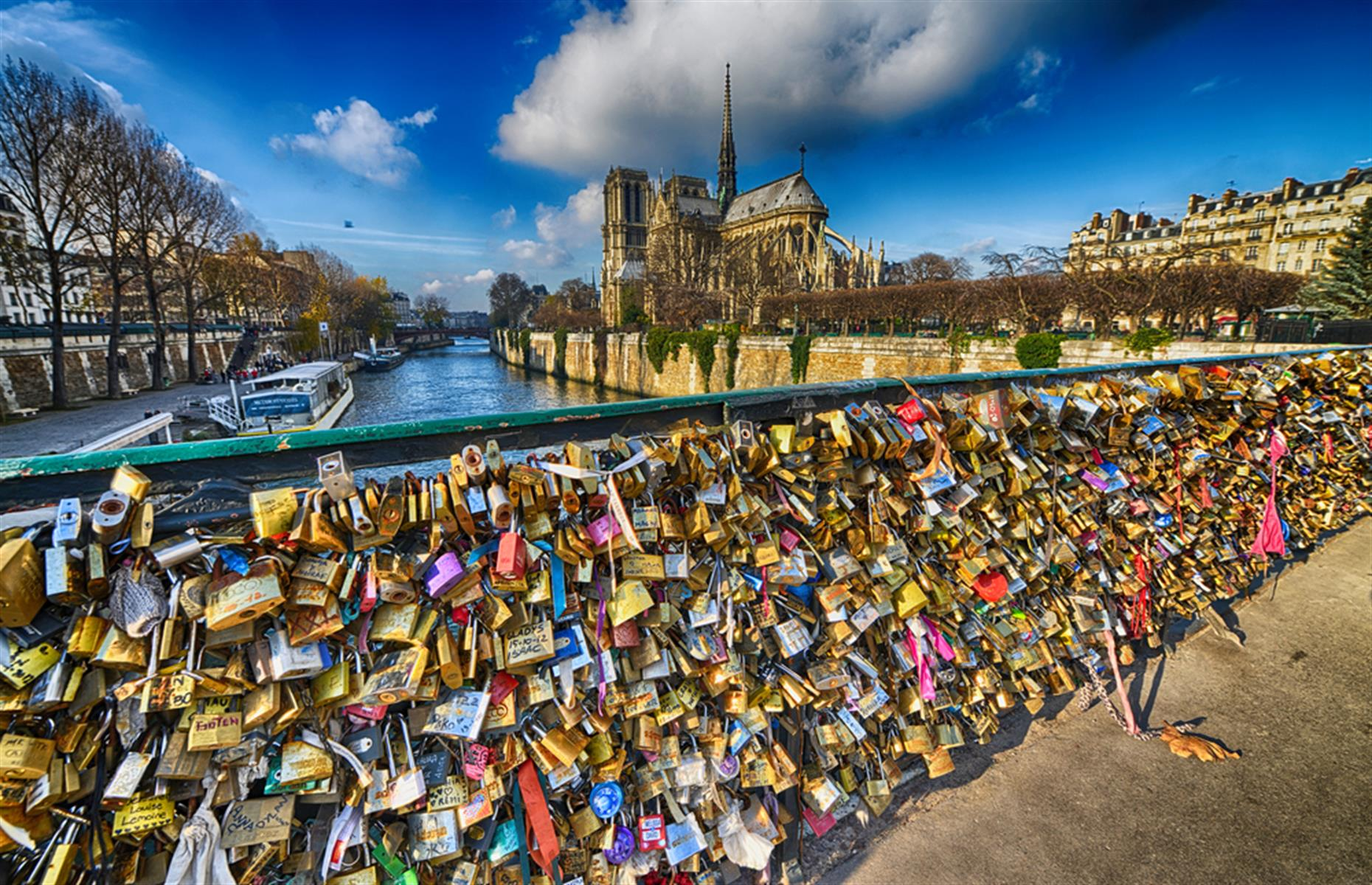 Slide 20 of 33: Hooking a 'love lock' with your initials on the Pont des Arts in Paris was the must-do thing for loved-up tourists. Millions of them were locked onto the bridge and it became so heavy that part of the railings collapsed.