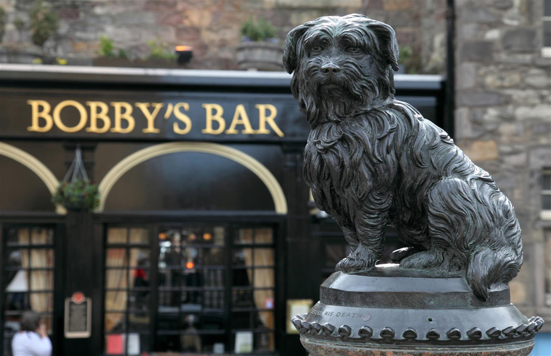 Slide 12 of 33: In Edinburgh, Scotland, Greyfriars Bobby, the life-size statue of the terrier who supposedly guarded his owner's grave for 14 years, attracts visitors from all over the world. But it's to the detriment of the sculpture.