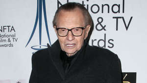 Larry King holding a sign posing for the camera: In a television special with CNN, the US talk show host said he wanted to be frozen so that when society finds the cure to whatever killed him they can bring him back to life. He went on to explain to shocked attendees that his disbelief in an afterlife was the main motivator in why he wants to become immortal.