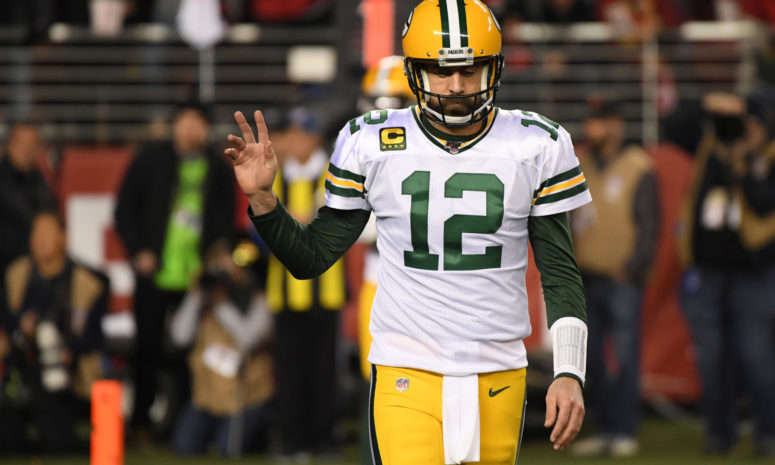 a football player wearing a helmet: Aaron Rodgers in the NFC Championship Game loss to San Francisco.
