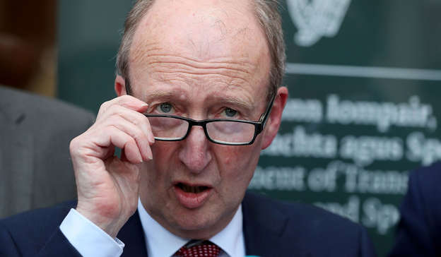 Shane Ross wearing a suit and tie talking on a cell phone: 'My view now would be that it was kept from the cabinet and from Finian [McGrath] and me for the three months, from March 11 because they knew there would be a row in cabinet between them and us.' Pic: Brian Lawless/PA Wire