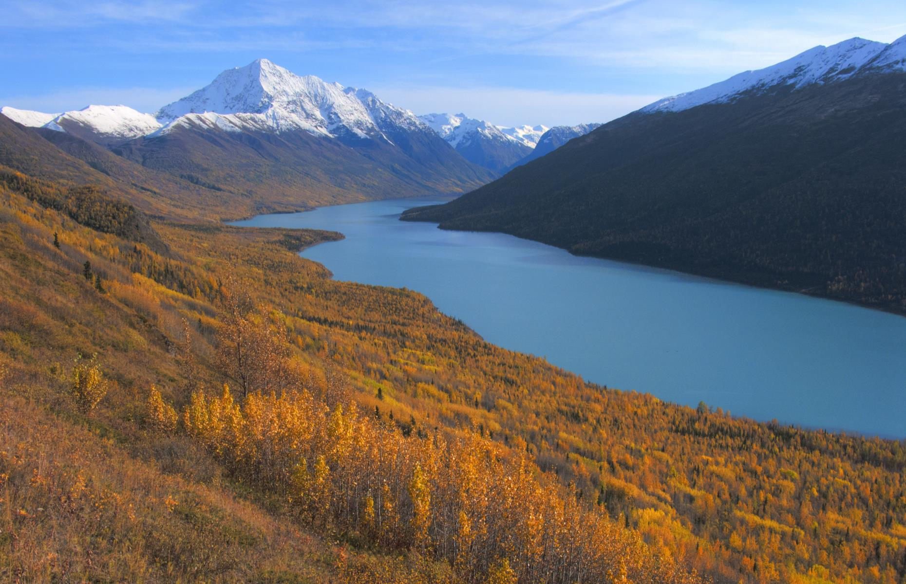 Slide 14 of 35: Flanked by the fall's vibrant oranges and reds in this stunning shot, the seven-mile long (11km) Eklutna Lake is backdropped by majestic mountains, the tallest of which is Bashful Peak. It's a favorite spot of hikers, with ample trails to try including the two-and-a-half mile (4km) Twin Peaks Trail, and the 13-mile (21km) Eklutna Lakeside Trail. Alternatively, thrill-seekers can take a three-and-a-half-hour quad bike tour with locally-owned Riding Alaska ATV Tours, which takes visitors through the Chugach State Park and traverses along the lake, up towards the Eklutna Glacier itself.