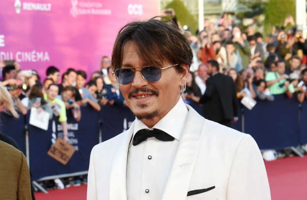 Johnny Depp wearing a suit and tie