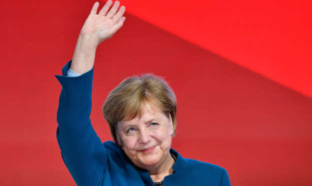 Slide 1 of 15: TOPSHOT - German Chancellor and leader of the Christian Democratic Union (CDU) Angela Merkel waves after delivering her speech at a party congress of Germany's conservative Christian Democratic Union (CDU) party on December 7, 2018 at a fair hall in Hamburg, northern Germany. - German Chancellor Angela Merkel will hand off leadership of her party after nearly two decades at the helm, with the race wide open between a loyal deputy and a longtime rival. (Photo by John MACDOUGALL / AFP)        (Photo credit should read JOHN MACDOUGALL/AFP/Getty Images)