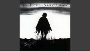 a person standing in front of a sunset: Provided to YouTube by Reprise  Harvest Moon · Neil Young  Harvest Moon  ℗ 1992 Reprise Records  Dobro, Marimba, Producer: Ben Keith Pedal  Steel  Guitar: Ben Keith Background  Vocals: Ben Keith Technical  Engineer: Harry Sitam Production: Joel Bernstein Assistant  Engineer: John Hausmann Mixing  Engineer: John Nowland Engineer: John Nowland Drums: Kenny Buttrey Background  Vocals: Linda Ronstadt Banjo, Piano, Producer, Vibraphone: Neil Young Mixing  Engineer: Neil Young Acoustic  Guitar: Neil Young Organ: Neil Young Lead  Vocals: Neil Young Keyboards, Piano: Spooner Oldham Organ: Spooner Oldham Bass  Guitar: Tim Drummond Marimba: Tim Drummond Digital  Editor: Tim Mulligan Mastering  Engineer: Tim Mulligan Mixing  Engineer: Tim Mulligan Engineer: Tim Mulligan Writer: Neil Young  Auto-generated by YouTube.