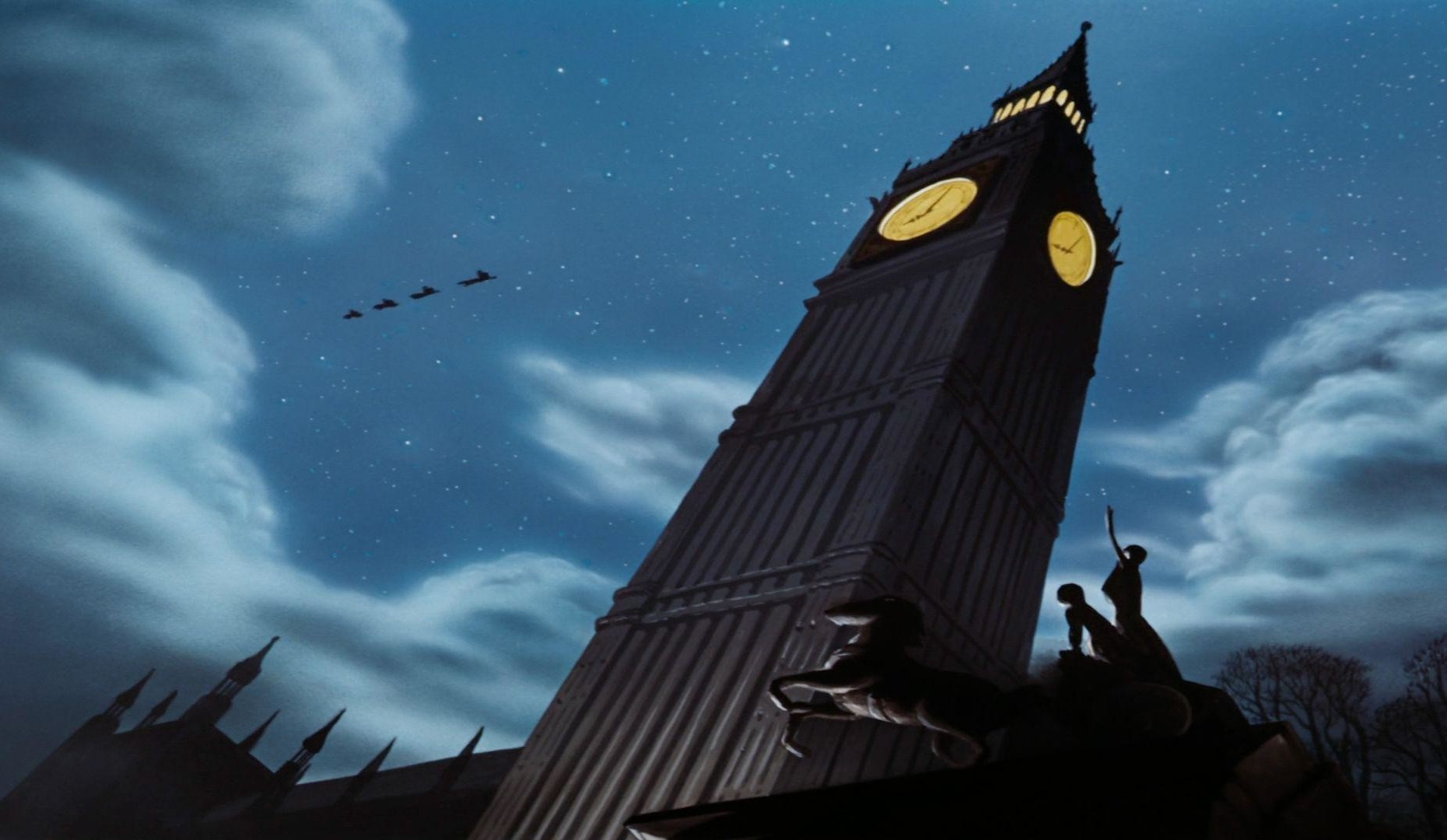 Slide 37 of 41: In the animated version, released in 1953, Peter takes the Darling children flying though the sky of England's capital city, and the group stops for a while to catch their breath on the roof of Big Ben.