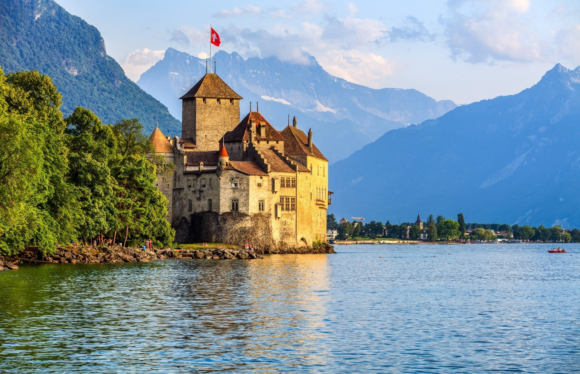 Slide 18 of 41: Prince Eric's castle in the movie The Little Mermaid was inspired by Chillon Castle on the banks of Lake Geneva in Switzerland.