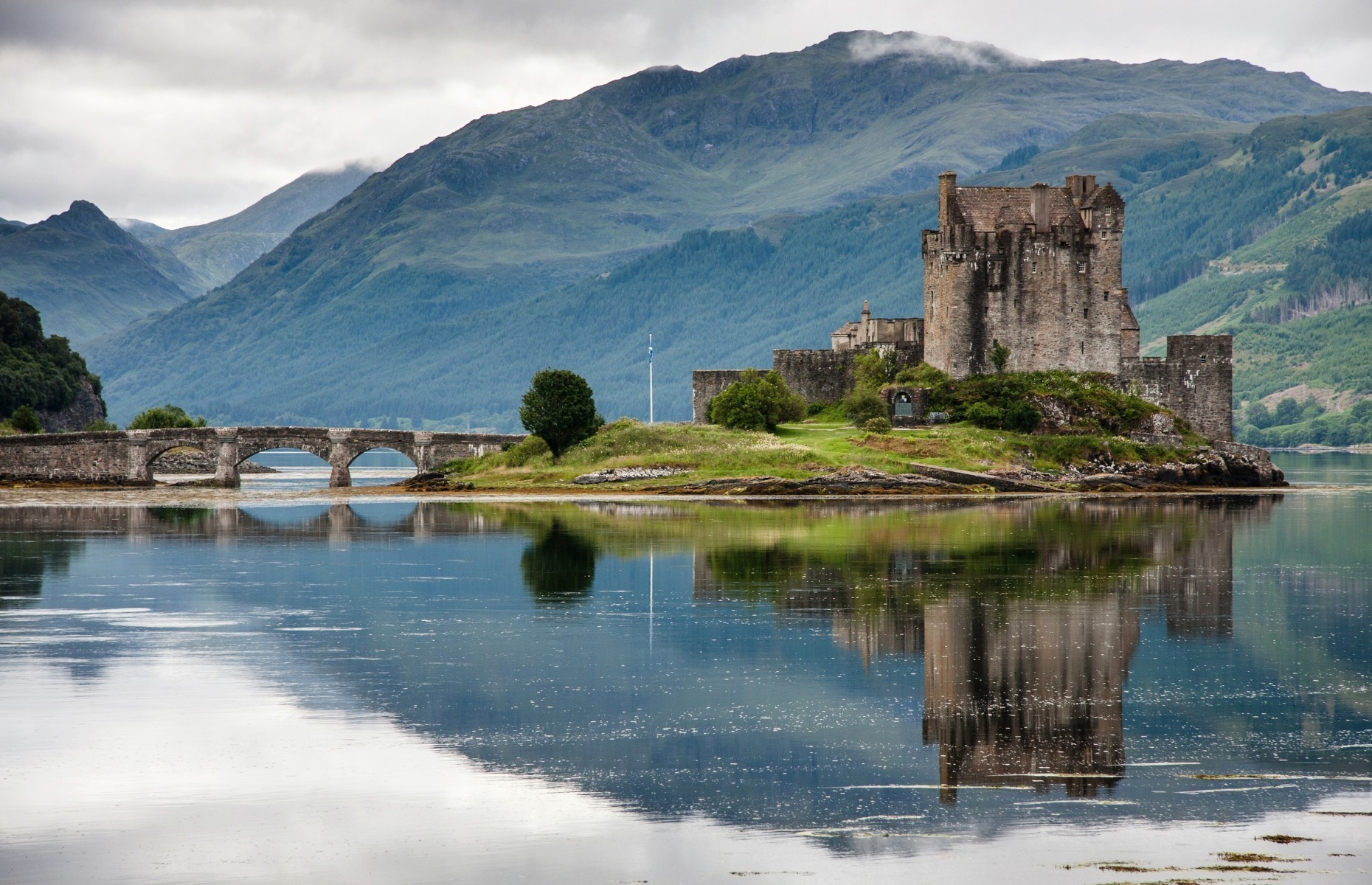 Slide 20 of 41: A team from Disney travelled to the Scottish Highlands to carry out research for the popular movie Brave, released in 2012, and Eilean Donan Castle provided the inspiration for the royal castle in the film.