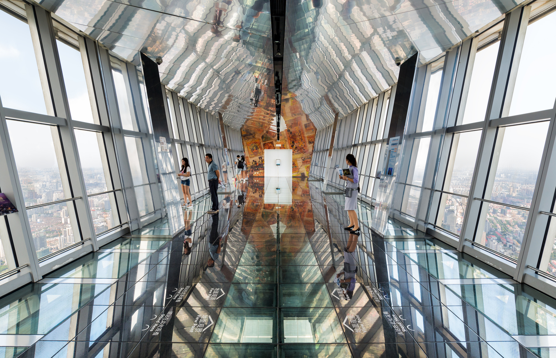 Slide 2 of 16: The Shanghai World Financial Center is currently the seventh‑highest building in the world. The 100th-floor observation deck is 474 metres (1,555 feet) above ground and has three transparent glass-floor walkways that show you Shanghai from a whole new perspective.