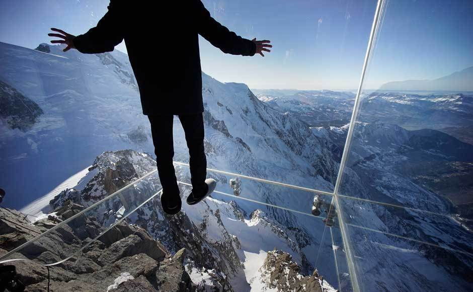 Slide 8 of 16: On the uppermost terrace of the Aiguille du Midi in the French Alps, you'll find Step Into the Void, a glass room with a glass floor hovering over a 1,000-metre (3,281-foot) drop. Not for the faint of heart!