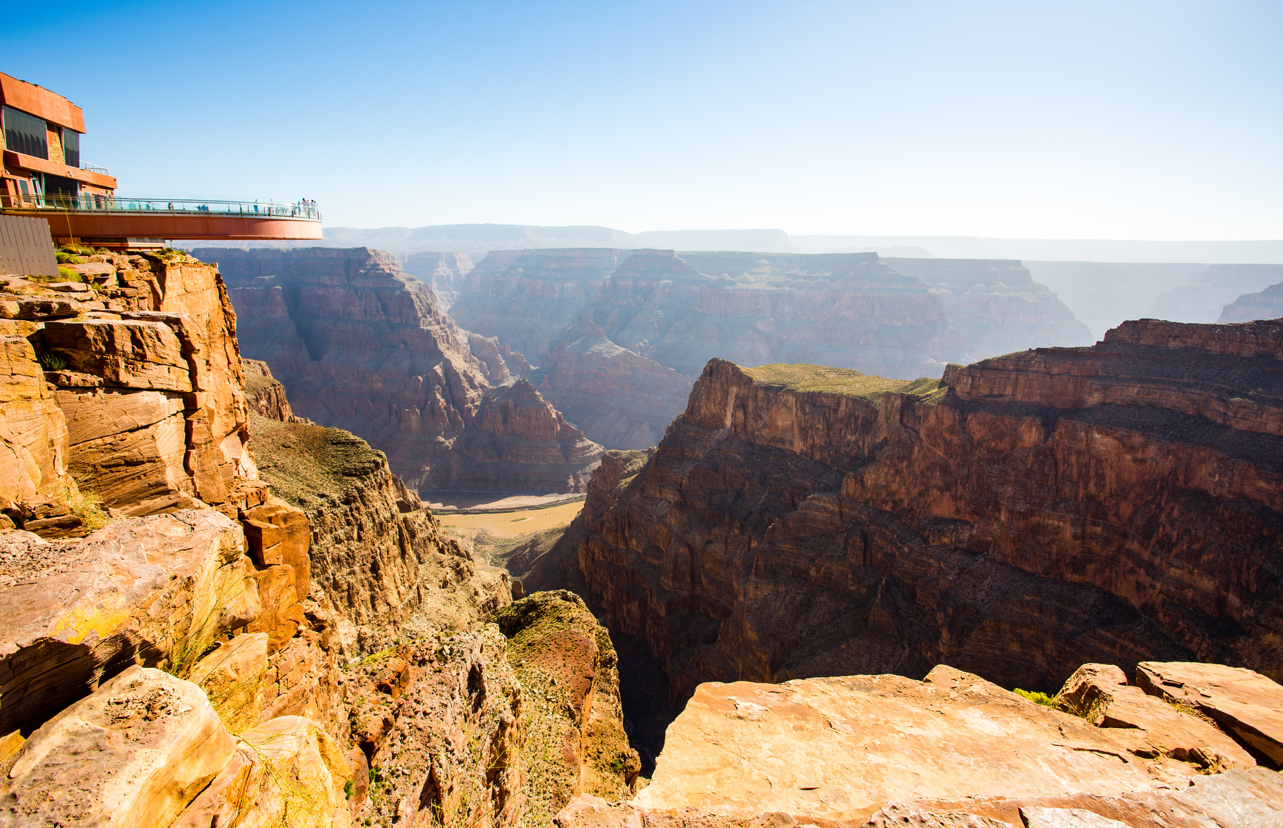 Slide 5 of 16: Ninety tonnes of glass were imported from Germany to build the Grand Canyon Skywalk. The first person to set foot on the platform was the famed astronaut Buzz Aldrin. Today, visitors can walk its length while admiring the views both around them and beneath their feet.