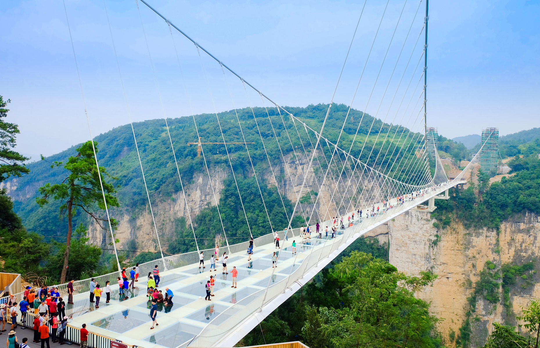 Slide 15 of 16: The glass-bottomed bridge over the Zhangjiajie Grand Canyon is 430 metres (1,411 feet) long. A few days after opening in 2016, the bridge had to close due to an overwhelming number of visitors. It has since reopened.