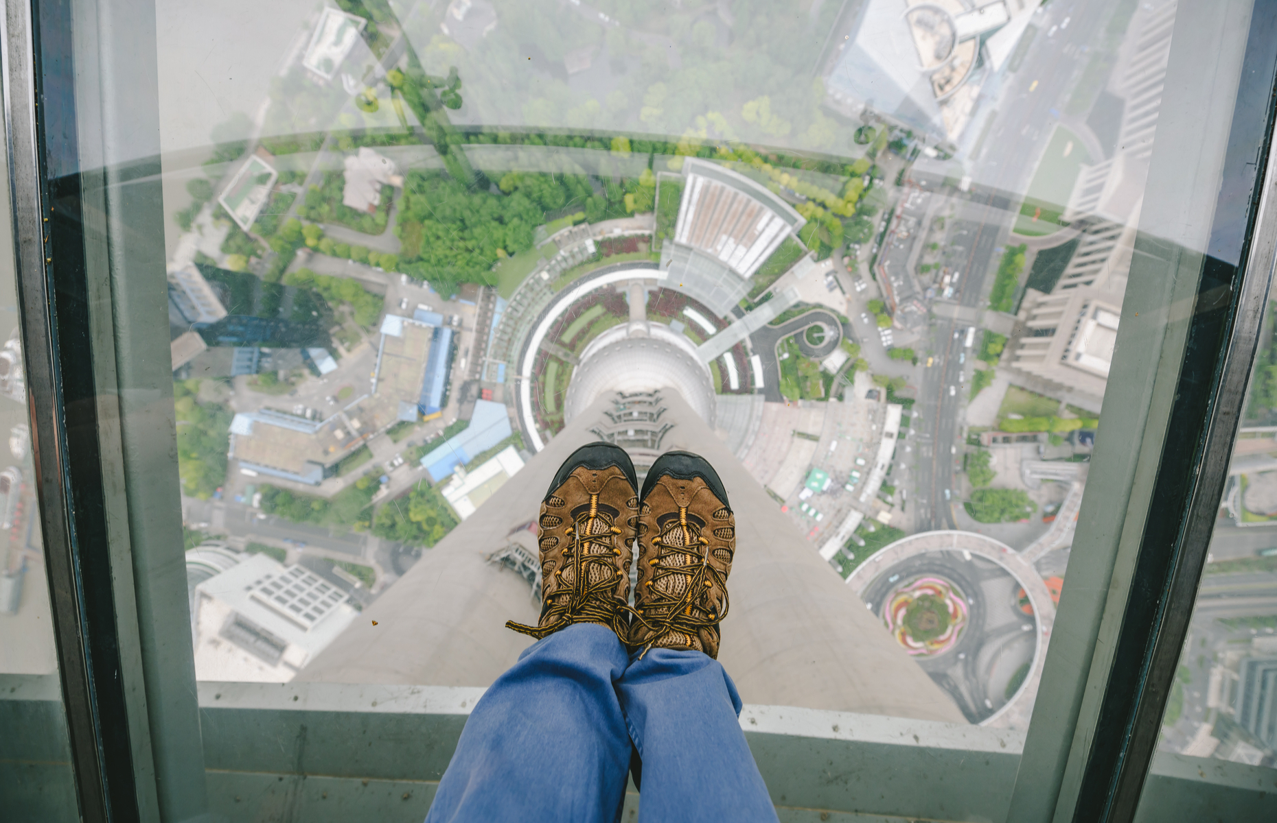 Slide 6 of 16: At the Oriental Pearl Tower, a radio and TV tower in Shanghai, the public can visit two observation decks at heights of 263 and 350 metres (863 and 1,148 feet) and dine in a revolving restaurant perched 267 metres (876 feet) above ground. There is a glass floor at the highest observation deck.