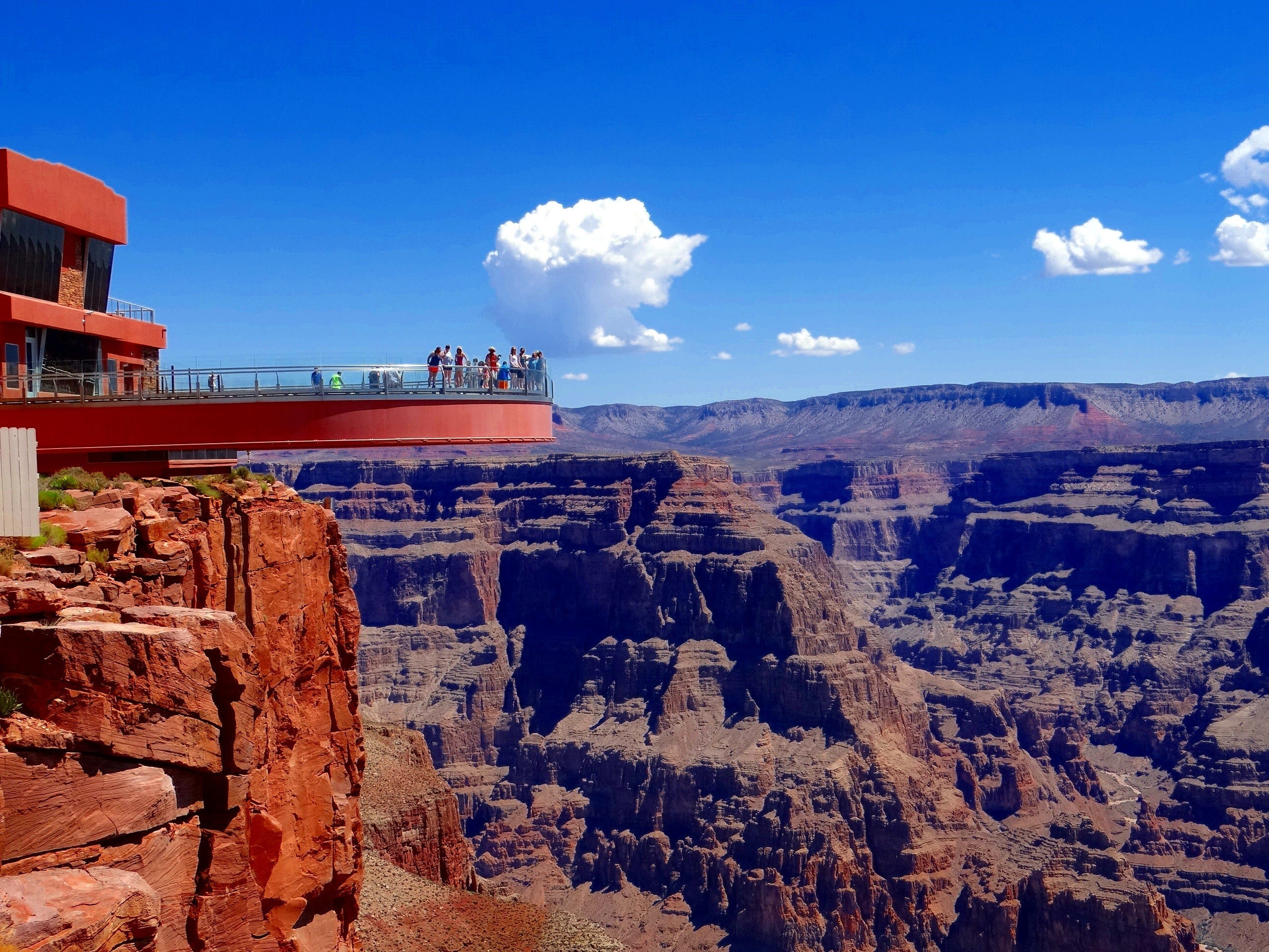 "Slide 5 of 11: The Grand Canyon Skywalk is located at Grand Canyon West. More than 1 million tourists visit the horseshoe-shaped walkway every year to see the Grand Canyon from 4,000 feet above the ground.Built on sacred Hualapai land, the site cost $30 million to construct. The tribe continues to manage the site after a legal battle between the tribe and the developer reached a settlement.""People come from all over the world and ask where the real Indians are. And I say, 'I am right here,'"" 24-year-old Luka Montana, a Hualapai singer who works at the Skywalk, told MyGrandCanyonPark.com. ""They think we are still living in teepees, hunting and gathering. But we have Dish Network. We live in houses."""