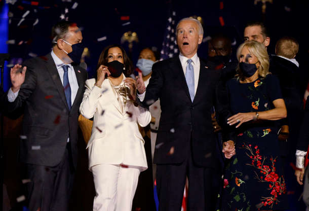 Slide 2 of 65: Democratic 2020 U.S. presidential nominee Joe Biden and his wife Jill, and Democratic 2020 U.S. vice presidential nominee Kamala Harris and her husband Doug, react to the confetti at their election rally, after the news media announced that Biden has won the 2020 U.S. presidential election over President Donald Trump, in Wilmington, Delaware, U.S., November 7, 2020. REUTERS/Jim Bourg     TPX IMAGES OF THE DAY