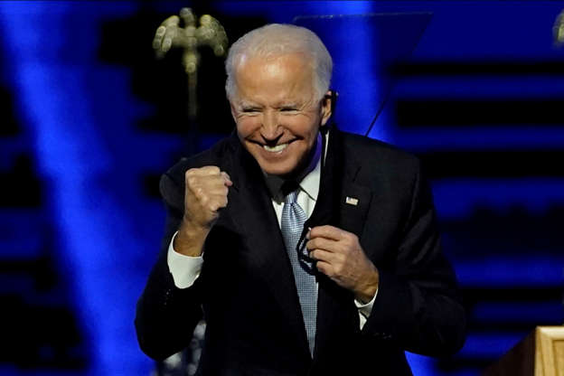 Slide 3 of 65: Democratic 2020 U.S. presidential nominee Joe Biden gestures at his election rally, after the news media announced that he won the 2020 U.S. presidential election over President Donald Trump, in Wilmington, Delaware, U.S., November 7, 2020. Andrew Harnik/Pool via  REUTERS     TPX IMAGES OF THE DAY
