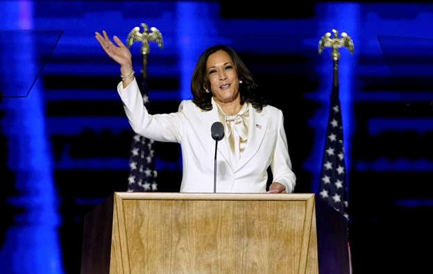 Slide 4 of 65: Democratic vice-presidential nominee Kamala Harris speaks to supporters at an election rally, after news media announced that Biden has won the 2020 U.S. presidential election, in Wilmington, Delaware, U.S., November 7, 2020. Andrew Harnik/Pool via REUTERS     TPX IMAGES OF THE DAY