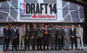 Elfrid Payton, Gary Harris, Adreian Payne, Nik Stauskas standing in front of a crowd posing for the camera: The 2014 NBA Draft is a memorable one because it featured two superstar centers, one of which (Nikola Jokic) wasn't drafted until the middle of the second round. The rest of the first round consisted of a number of high-level role players along with some players with loads of potential, but inconsistent production. There were also a couple of huge busts like Dante Exum and Nik Stauskas, so this draft a had a bit of everything.Let's see how things would shake out if we redrafted things today.