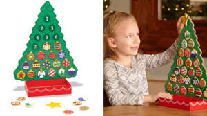 "a child sitting on a table: The Melissa & Doug Advent calendar features 24 magnetic ""ornaments""."