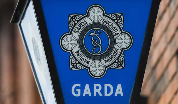a close up of a sign: Gardai are appealing for information following an armed cash in transit robbery that took place outside of a post office in Dublin. Pic: Artur Widak/NurPhoto via Getty Images