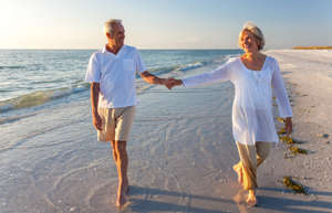 """a man and a woman standing on a beach: What does it take to retire a millionaire? Mathematically, that's easy to answer. If your savings are growing at 7% annually, you can reach $1 million by contributing $400 monthly for 40 years or $815 monthly for 30 years. You could also calculate thousands of other combinations of growth rates, monthly contributions, and timelines. Unfortunately, math is only part of the, ahem, equation.You also need to know a few investing tricks to make your targeted growth achievable. Here are 10 investment strategies to turn that long stream of retirement contributions into a seven-figure balance over time.5 Winning Stocks Under $49We hear it over and over from investors, """"I wish I had bought Amazon or Netflix when they were first recommended by the Motley Fool. I'd be sitting on a gold mine!"""" And it's true. And while Amazon and Netflix have had a good run, we think these 5 other stocks are screaming buys. And you can buy them now for less than $49 a share! Simply click here to learn how to get your copy of """"5 Growth Stocks Under $49"""" for FREE for a limited time only."""