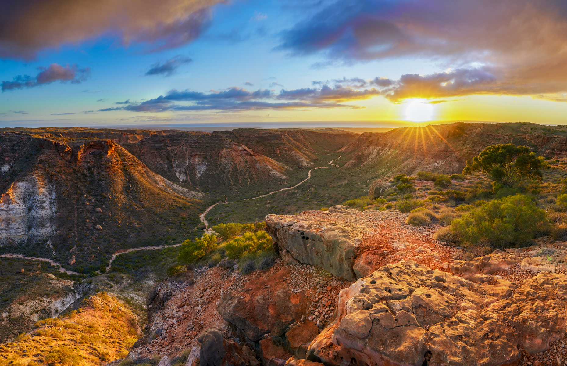 Slide 6 of 21: Trek up the Charles Knife Road in Cape Range National Park for an incredible sunrise view of the surrounding gorges and ranges, like the Charles Knife Canyon seen here. The Exmouth Gulf next door also boasts extensive ecosystems and reefs.