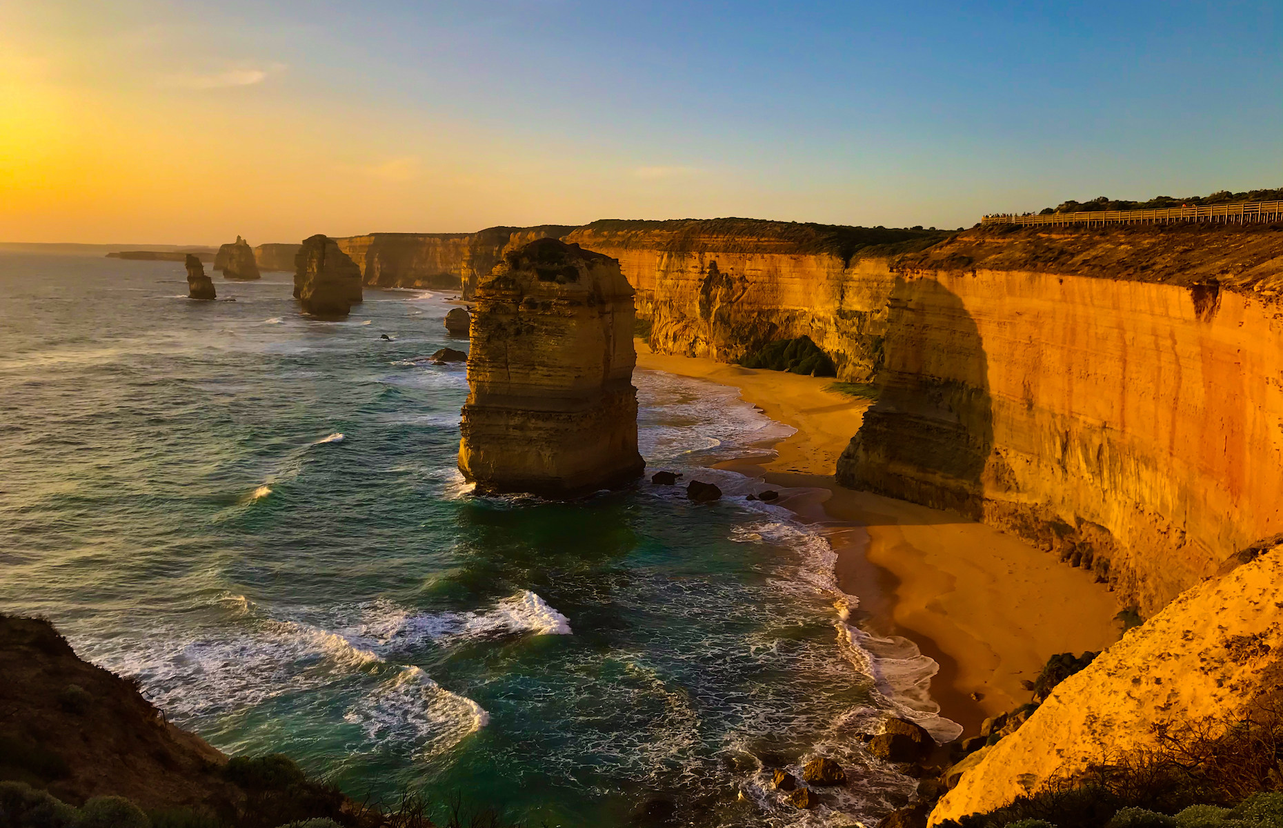 "Slide 5 of 21: In Victoria, these majestic limestone stacks, dubbed the Twelve Apostles (formerly ""the Sow and Piglets""), are a highlight of the Great Ocean Road. Though only eight remain today, the rock formations stand tall amidst crashing waves—a breathtaking sight from the cliff tops."