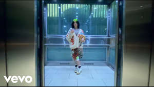 "a person standing in front of a computer: Listen to ""Therefore I Am"", out now: https://smarturl.it/ThereforeIAm   Directed by Billie Eilish   Follow Billie Eilish: Facebook: https://www.facebook.com/billieeilish Instagram: https://www.instagram.com/billieeilish Twitter: https://twitter.com/billieeilish YouTube: https://www.youtube.com/BillieEilish Email: http://smarturl.it/BillieEilishEmail Store: http://smarturl.it/BillieEilishStore  Music video by Billie Eilish performing Therefore I Am. © 2020 Darkroom/Interscope Records"