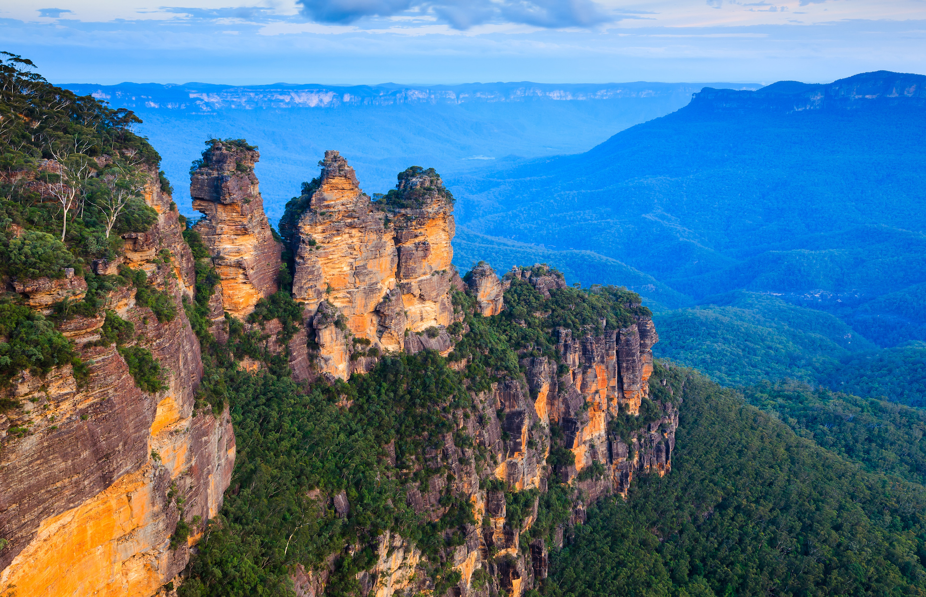 Slide 8 of 21: Taken from Echo Point lookout, the Three Sisters are the Blue Mountains' most iconic landmark. Named for an Indigenous myth of sisters from the Katoomba tribe turned to stone, the rock formations stand almost 1,000 metres (3,000 feet) above sea level.