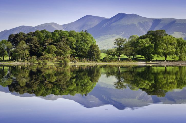 Slide 45 of 52: The Lake District in England is known worldwide as a destination for lake aficionados. Derwentwater is one of the largest in the district, with a serene landscape that highlights the forested hills of Cumbria.