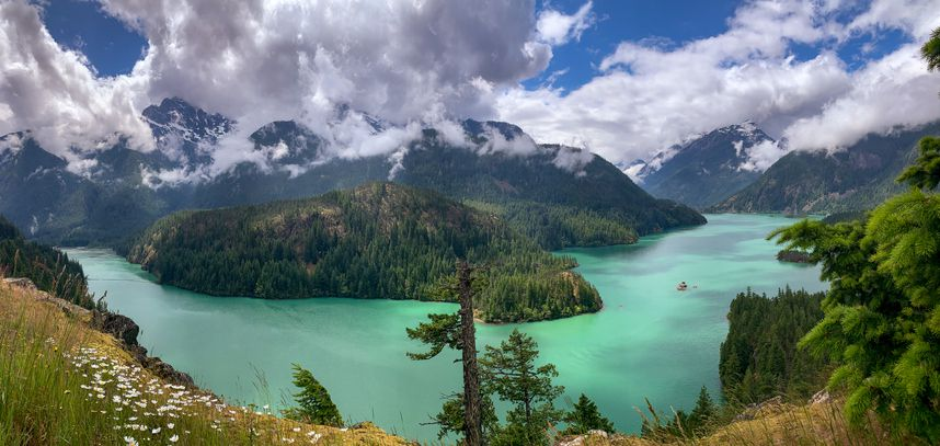 Slide 6 of 52: Nope, this isn't photoshopped. Diablo Lake's unwordly turquoise water is caused by suspended rock particles that sift into the lake after being ground up by surrounding glaciers.