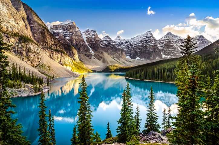 Slide 30 of 52: Like Lake Louise, Moraine Lake is located in Alberta's Banff National Park. Rugged landscape and surrounding mountains make this alpine lake a photographer's dream.