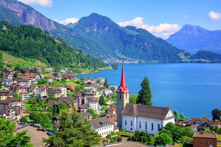 Slide 12 of 52: Quaint lakeshore villages and the snowy Swiss Alps reflected in its serene blue waters? Check. Lake Lucerne is another alpine wonder.