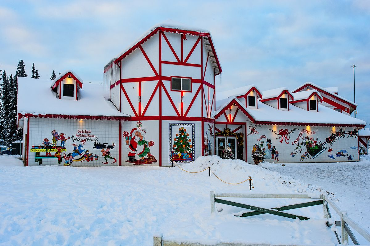 Slide 2 of 34: It doesn't get more Christmasy than visiting a town named after Santa Claus' home. Though this North Pole isn't the same as the mythical home of jolly ol' Saint Nick, it is filled with Christmas spirit, live reindeer, a mayor named Santa, and candy cane street lamps.