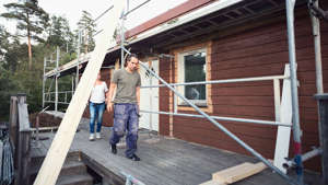 a man standing on a bridge: Construction a home with two people inspecting