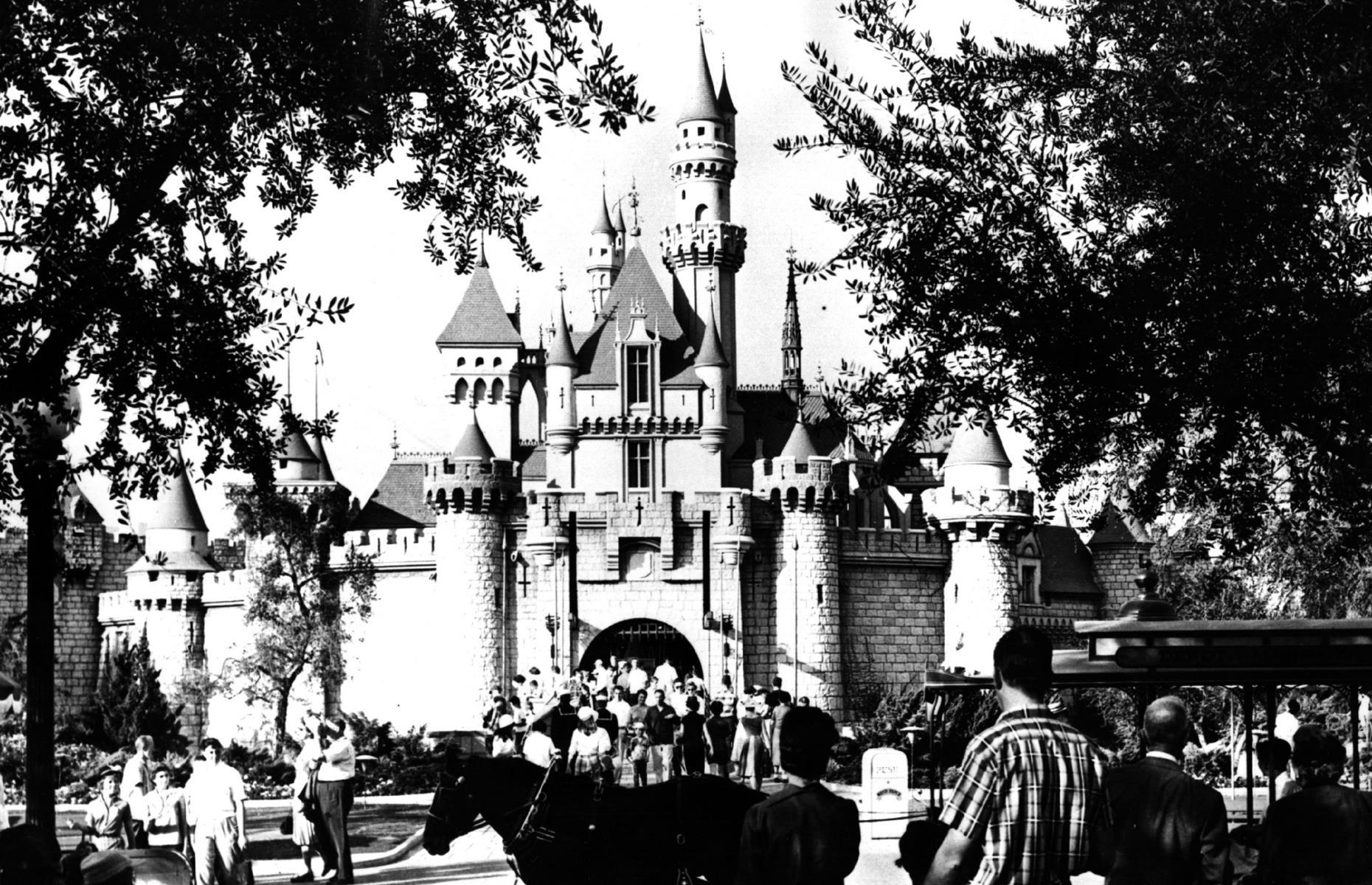 Slide 26 of 48: Walt Disney's Disneyland (renamed Disneyland Park in the 1990s) opened on 17 July 1955. He originally wanted his theme park to be called Mickey Mouse Park.On the opening day, 28,000 people visited the theme park which featured its now-famous parades and 20 different attractions including Frontierland, a recreation of the Old West, pictured here in 1955. There was also the Sleeping Beauty Castlewhich soon became one of the USA's most recognizable tourist attractions. Seemore historic pictures of Disney's parks here.