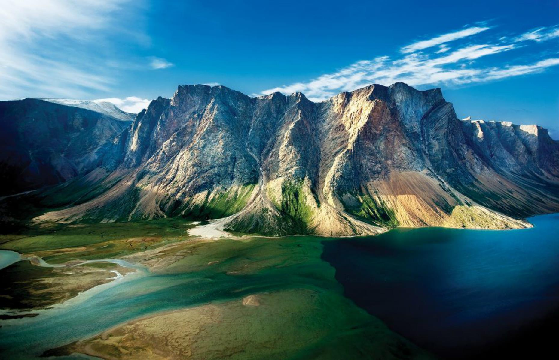 Slide 24 of 31: This Inuit-run reserve is as remote as it gets, with more than 3,745 square miles (9,700sq km) of wonderful, windswept wilderness on Canada's far north Labrador Peninsula. The Torngat Mountains form its jagged heart while a glorious patchwork of fjords, glaciers and rock-strewn meadows sprawls to a coastline where icebergs regularly drift past. There are no roads, trails or signs anywhere in the park, and its inaccessibility has allowed polar bears, caribou, Arctic foxes and wolves to thrive.