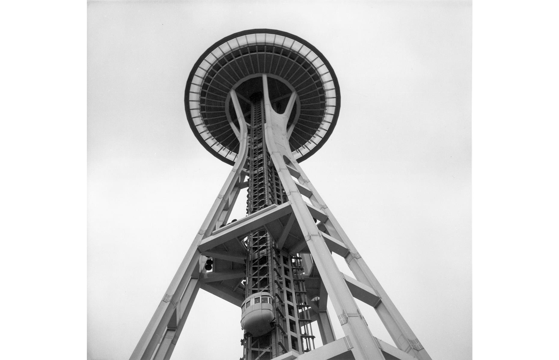 Slide 29 of 48: Seattle's futuristic landmark, the Space Needle, officially opened to the public on 21 April 1962. It was built as part of the Century 21 Exhibition, a space-age themed World Fair. During the event, more than 20,000 people used the elevator to reach its summit each day, drawing more than 2.3 million visitors overall. Usually around 1.3 million people now visit the 600-foot-tall structure each year.