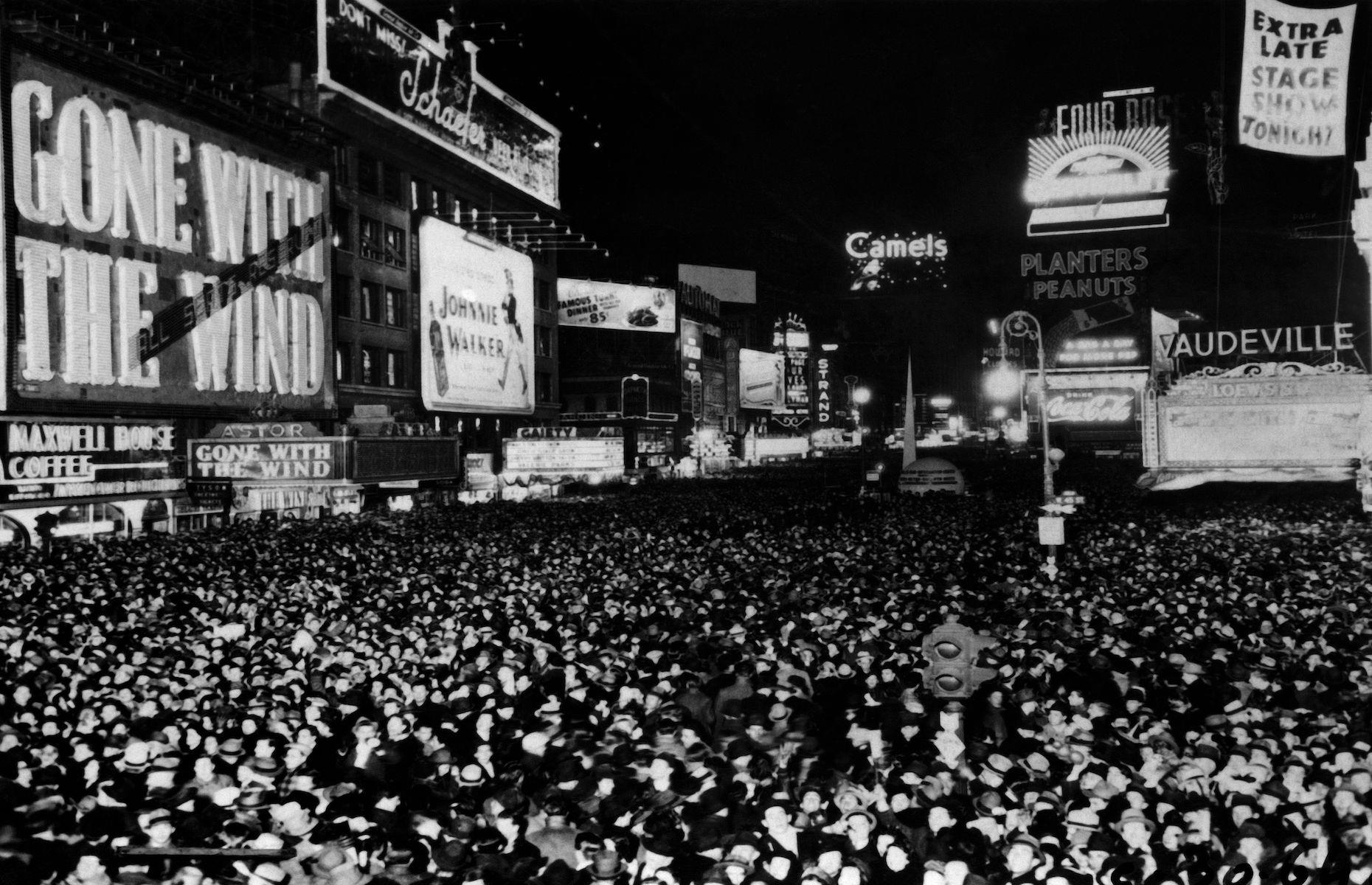 Slide 5 of 48: Formerly known as Longacre Square, Times Square was renamed in 1904 after The New York Times moved its headquartersthere. The junction of Broadway and Seventh Avenue has since become one of the most famous commercial squares in the world with its theaters, cinemas and electronic billboards. It's also the site of the city's annual New Year's Eve ball drop (pictured here in 1939), a tradition which began when the newspaper held a New Year's Eve event to celebrate itsmove.
