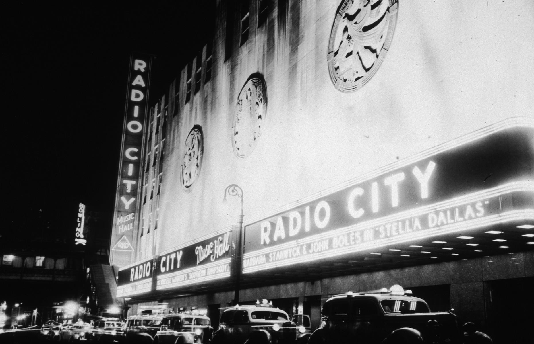 """Slide 20 of 48: Manhattan's legendary venue, Radio City Music Hall, first opened on Sixth Avenue in 1932 as a cornerstone of John D. Rockefeller Jr's subsequent Rockefeller Center. The Art Deco theater was conceived as a """"palace for the people"""", offering top entertainment at affordable prices. It became a popular spot for film premieres with 700 movies having opened here since 1933, including the original King Kong and Breakfast at Tiffany's. Its Great Stage has also welcomed legendary artists such as Frank Sinatra."""