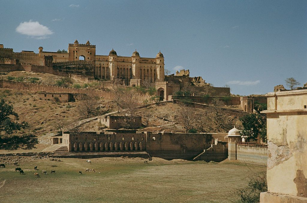 Slide 27 of 31: Amer Fort (sometimes also called Amber Fort), is one of the most popular historical monuments in the city of Jaipur, and is pictured here in 1965. It's a well-preserved monument from the time of Rajput rule in Rajasthan, and the design is an interesting mix of Hindu and Muslim styles.