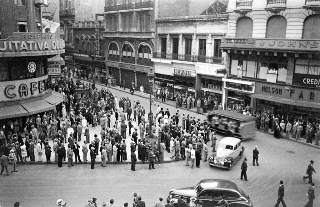 Slide 14 of 31: Buenos Aires was founded in 1536 by Spanish explorer Pedro de Mendoza, and quickly became a very popular city. The tango dance actually originated from Buenos Aires in the 19th century. In this photo from 1946, you can see workers gathered on the street in a protest.