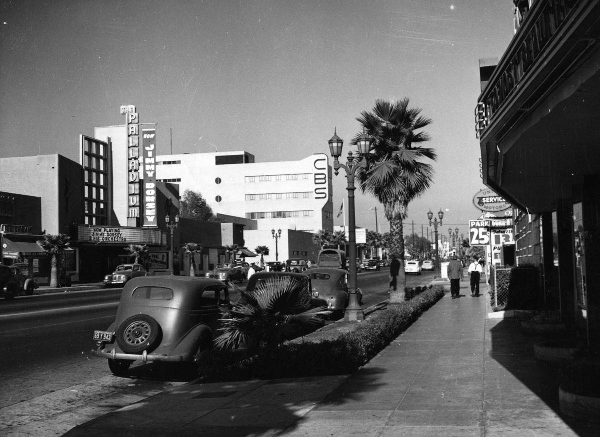 Slide 26 of 31: Sunset Boulevard, otherwise known as the Sunset Strip, is one of the most iconic streets in Los Angeles, and has been a haven for celebrities since the beginning. It started off as a tiny dirt road and expanded into a a bustling street full of shops, historic buildings, and more. This photo from 1945 shows the Palladium, where Jimmy Dorsey was playing, and the CBS building.