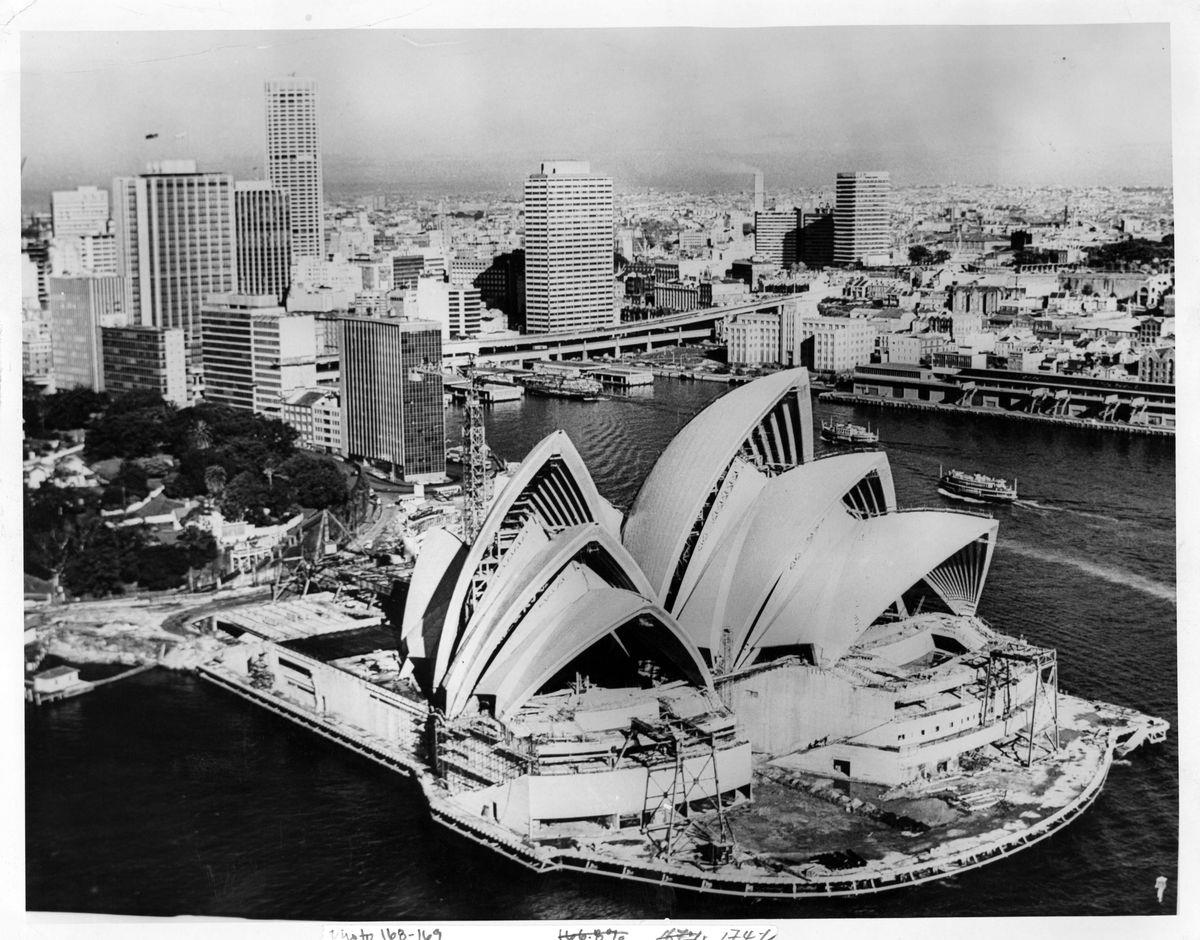Slide 12 of 31: Easily the most iconic building in Australia, the Sydney Opera House took 14 years to build and was finished in 1959 - in this photo from 1955, you can see work is still being done to it. It has since been home to many of the world's greatest artists and performers.