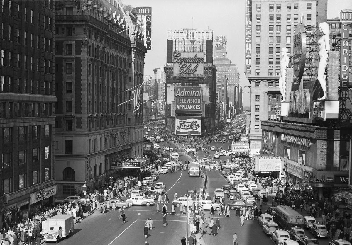 Slide 2 of 31: Times Square became a popular spot in New York City back in the early 1900s. By 1905, it was a hub filled with theaters, restaurants, and shops, just like today, and although the Great Depression hurt the area and vendors, this photo from 1953 shows that it bounced back pretty well.