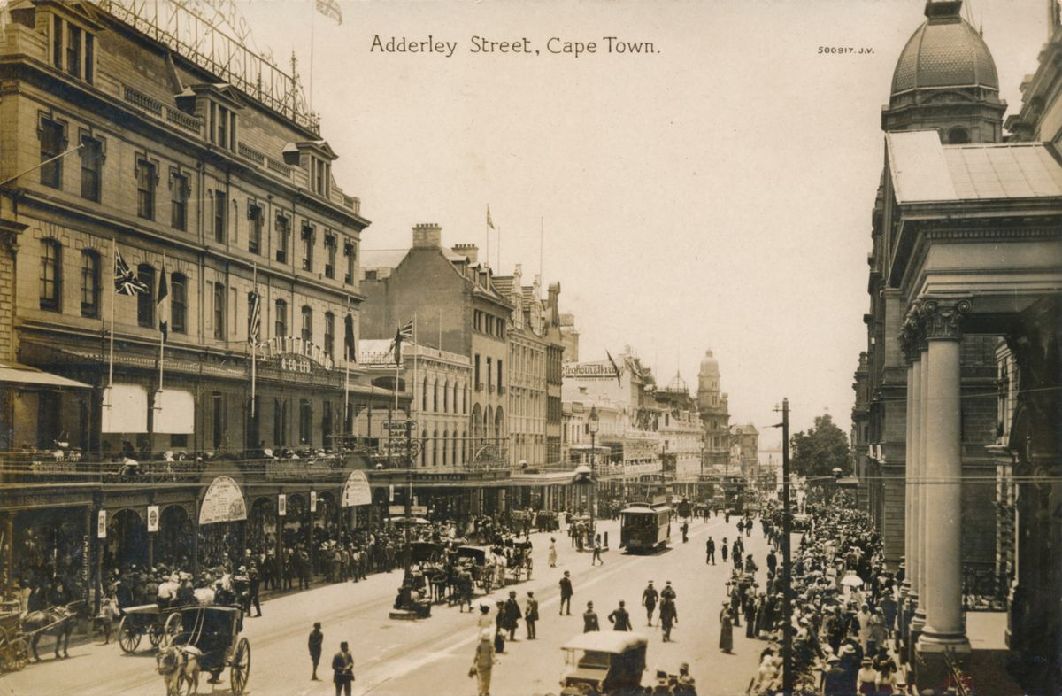 Slide 7 of 31: This photo from about 1900 shows an old image of Adderley Street in Cape Town. It's the main street in the business district of Cape Town, and has been since way back in the day: originally called the Heerengracht, it was changed to Adderly Street in 1850 in honor of Charles B. Adderley, a British member of Parliment.