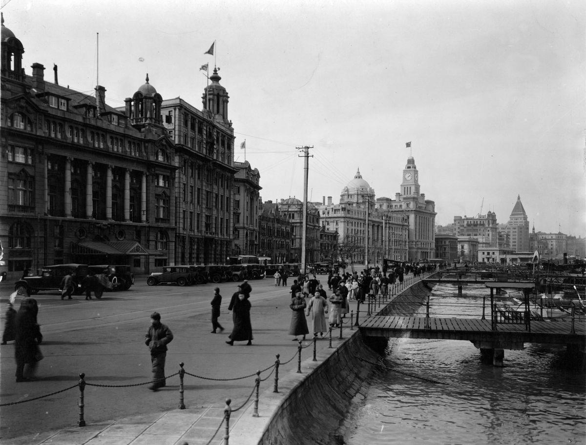 Slide 30 of 31: The Bund, pictured here back in 1950, is a famous waterfront on the Huangpu River and is thought of as the symbol of Shanghai. This popular walkway is home to so many important landmarks, like the Shanghai Tower and Shanghai World Financial Centre.