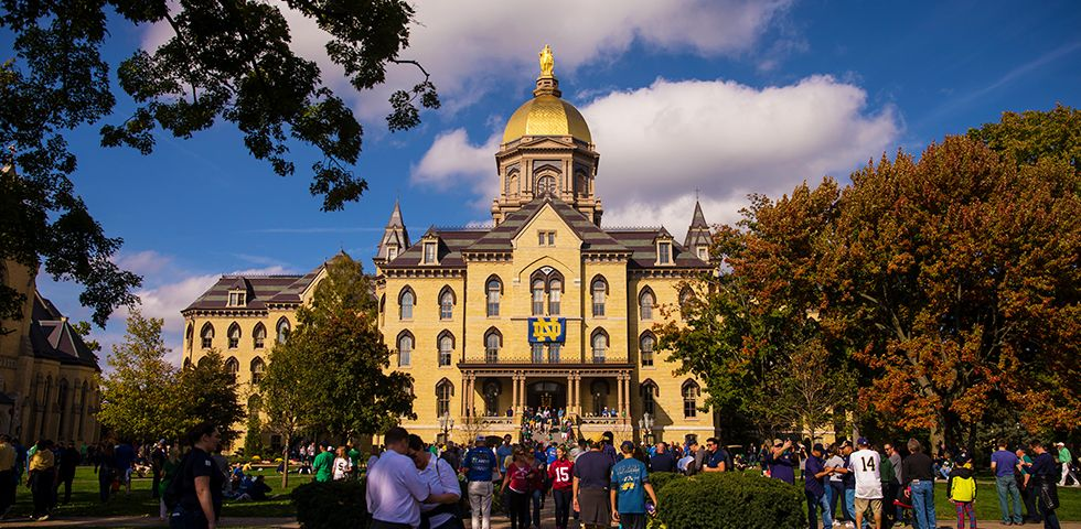 Slide 20 of 41: Notre Dame University boasts an impressive 143 buildings on 1,250 acres just south of the Indiana Toll Road. The university's most distinguishable feature is the Golden dome atop the main building (the original burned down in 1879). The gold dome inspired the metallic helmets of the fighting Irish football team,which plays in the famous Notre Dame Stadium in front of more than 80,000 people on Game Day.