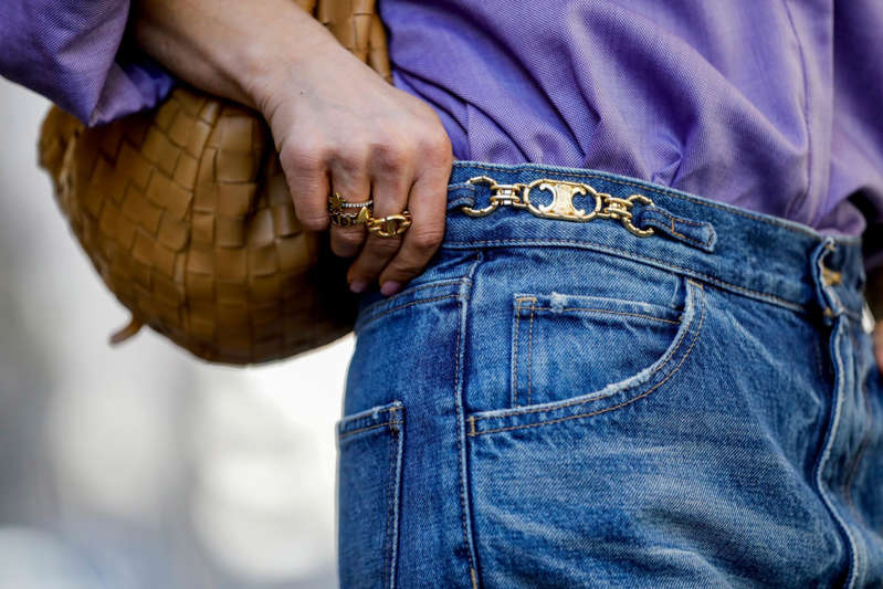 a person wearing a blue shirt: Streetstyleshooters/Getty