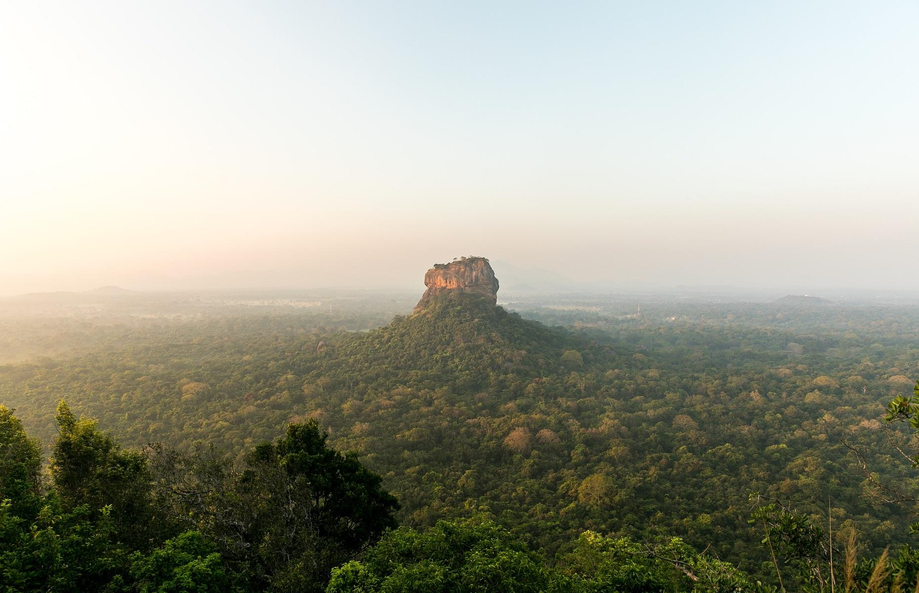 Slide 4 of 51: Jutting out of the plains and forests of northeast Sri Lanka, Sigiriya is one of the country's most spellbinding sights. It's hard to imagine the imposing 656-foot (200m) rock fortress lay forgotten by the outside world until British historians rediscovered it in the 19th century. Built by the king Kashyapa I in the 5th century AD, its name means lion's rock and the entrance is guarded by a pair of giant lion paws. With a mighty 1,200 steps to the top, the views across the pleasure gardens, jungle and beyond are entrancing. Discover the world's most beautiful ancient cities here.
